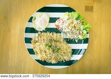 Thai Sour Pork Fried Rice And Salad And Fried Egg In Dish On Wood Table On Top View Or Flatlay View