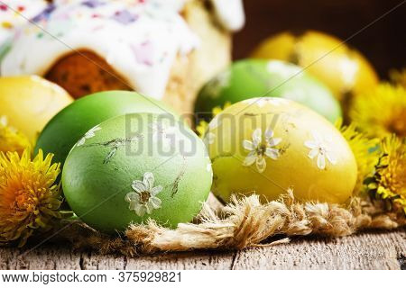 Easter Green And Yellow Painted Eggs, White Apricot Flowers, Spring Festive Composition In Rustic St