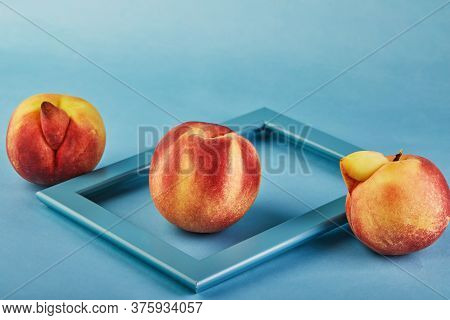 An Ugly Fruit Or Vegetable. Concept Fresh Peach In A Frame And Two Very Ugly Peaches Mutant Out On A