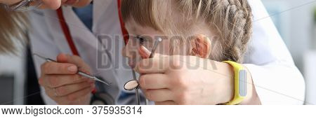 Pediatric Dentist Examines Teeth Little Girl. Examination Oral Cavity In Children At Various Age Per