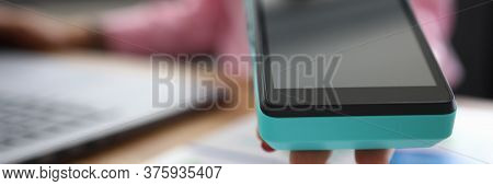 Close-up Girl Offers Portable Banking Terminal. Cashback Card, Small Percentage Purchase Is Returned