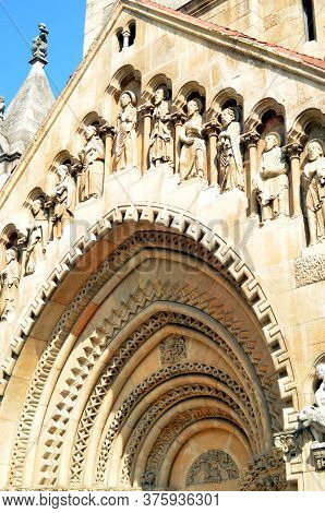 Budapest, Hungary - 09 14 2019: Openwork Arch With Figures Of Saints Above The Entrance To The Medie