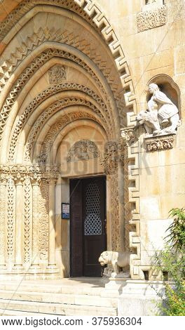 Budapest, Hungary - 09 14 2019: Entrance To The Medieval Fortress Through An Openwork Arch With Scul