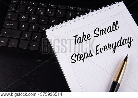 Take Small Steps Everyday - Written On A Notebook With A Pen.