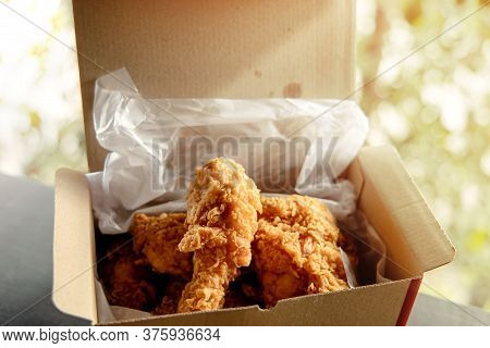 Crispy Fried Chicken In A Paper Bucket Box. Natural Sunlight