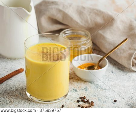 Moon Milk For Better Sleep. Turmeric Golden Milk With Cinnamon, Honey. Ayurvedic Drink. Trending Dri