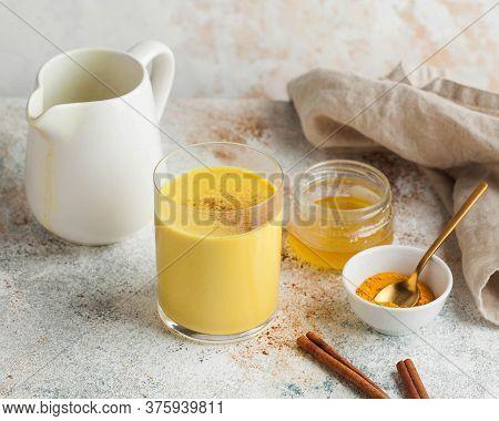 Moon Milk For Better Sleep. Turmeric Golden Milk With Cinnamon, Honey. Ayurvedic Drink. Trending Dri