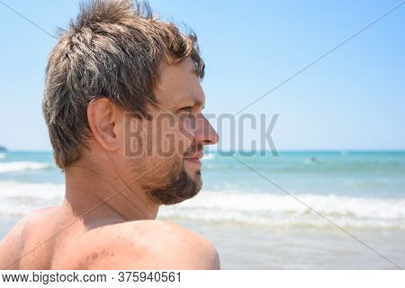Portrait Of An Overgrown Man Of Forty Years Against The Background Of The Sea