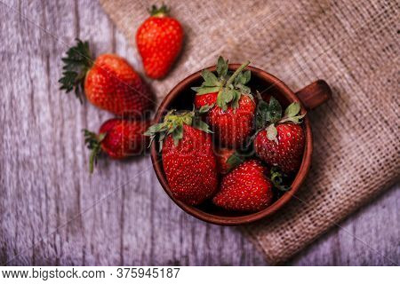 Fresh Juicy Organic Strawberries In An Old Clay Bowl.