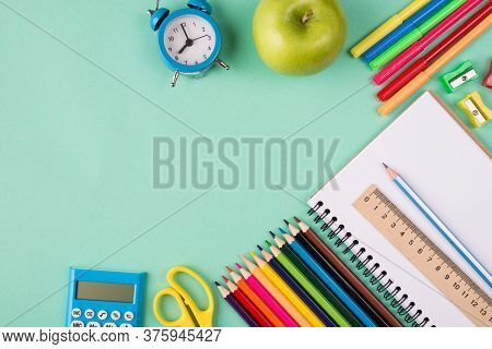 Back To School Concept. Top Above Overhead View Photo Of Colorful School Stationery Blue Clock And A