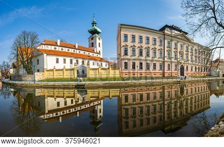 Church of Presentation of the Blessed Virgin Mary and Dominican Monastery are famous gothic landmarks of Ceske Budejovice. Reflection in river Malse. Czech Republic
