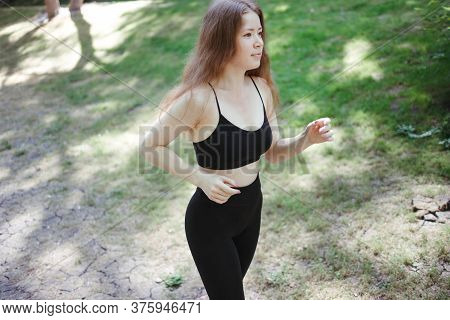 Sport, Fitness, Healthy Lifestyle, Cardio Training. Active Woman With Athletic Body Running In The P