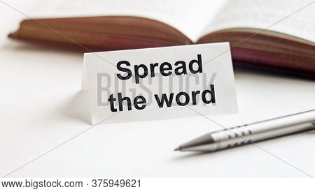 Piece Of Paper With Text Spread The Word On The Background Of Books, Pens, On A White Background