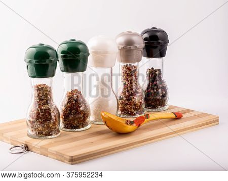 Set For Cooking Delicious Dishes. A Mixture Of Spices In Jars. Various Herbs, Sea Salt, Hot Pepper,