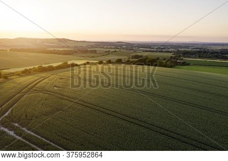 Stunning drone landscape image over lush green Summer English countryside during late afternoon light