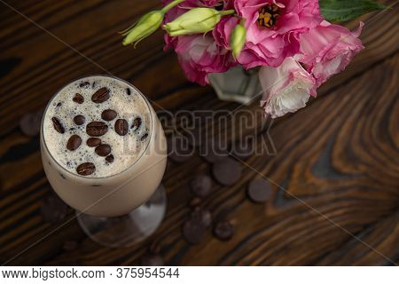 Coffee Drink Frappe. On A Brown Wooden Table.