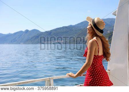 Traveler Tourist Woman Enjoying Breeze Relaxing On A Cruise Boat Lake Como