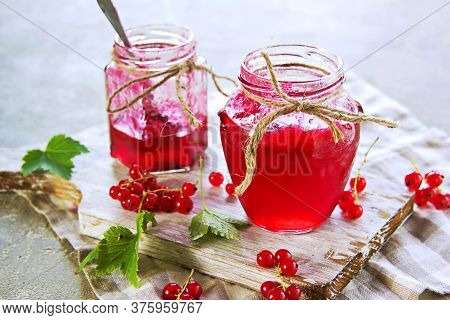 Homemade Red Currant Jam In Curly Jar On A Light Gray Concrete Background. Jam Recipes. Harvest Berr