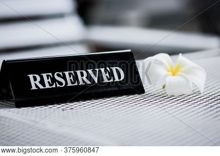 Reserved Metal Black Plate In A Restaurant. Reserved Metal Plate On The White Table. Vintage Photo P