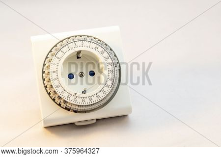Analogue Timer Switch To Set Your Light On Or Machine On A Certain Moment On A White Background
