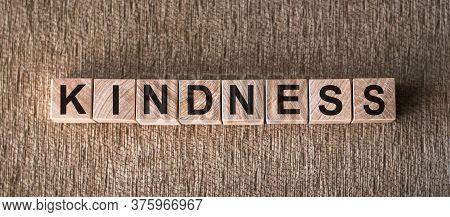 The Word Kindness Written In Wooden Blocks