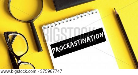 Procrastination. Motivation. Concept Meaning Delay Or Put Off Something Boring Written On A Notepad