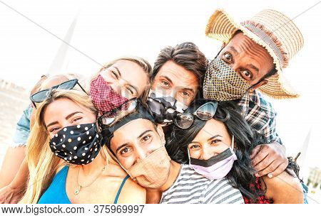 Multiracial Milenial Friends Taking Selfie Smiling Behind Face Masks - New Normal Summer Friendship