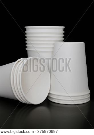 Close Up Stacks Of Paper Disposable White Blank Cups At Black Background, Take Away, Coffee To Go, C