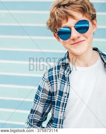 Blonde Hair 12yo Caucasian Teenager Boy Fashion Portrait Dressed White T-shirt With Checkered Shirt
