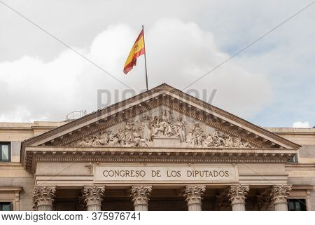 Madrid, Spain; April 2010: Facade Of The Congress Of Deputies In Madrid, With The Spanish Flag At Th