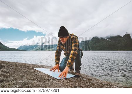 Man Looking At Map Planning Vacation Route Trip Traveling Solo In Norway Active Adventure Lifestyle