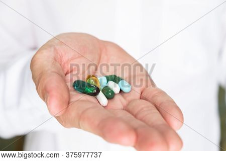 Selective Focus At The Medicine Pills. On The Doctor Palm With Different Type Of Drug Tablet.  Medic