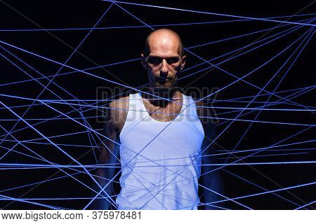 Adult Man Tangled In White Threads In Ultraviolet