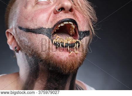 Scary Mad Man With Maggots In His Mouth