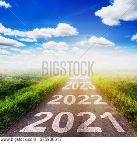New Year Goals Concept : Empty Asphalt Road Sunset And Happy New Year 2021.