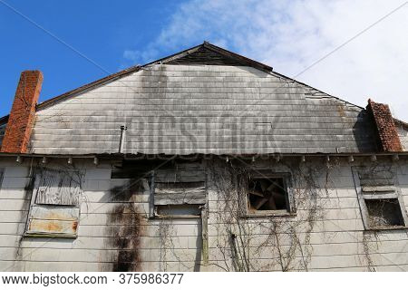 An Abandoned Dilapidated Weathered Old Factory Warehouse Building