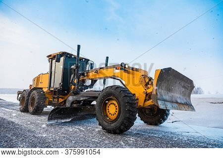 Motor Graders, Grader Road Construction. Industrial Machine On Construction Of Roads. Truck Moving O