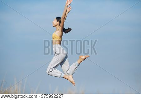 Cute Girl Training On A Sky Backgroung