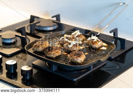 Cooking And Frying Meatballs In Pan / Turkish Kofte Or Kofta With Melted Cheese At Kitchen. Traditio