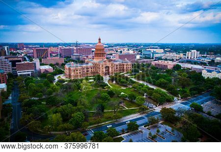 Sunset at the Texas State Capitol building in Austin Texas USA aerial drone views of the capital cities government political building surrounded by green space on a perfect evening sunset