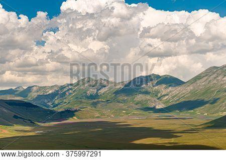 The Plateau Of Castelluccio Di Norcia, In The Monti Sibillini Park, The Natural Border Between Umbri