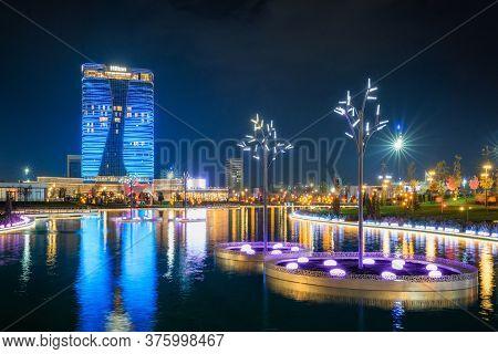 Tashkent, Uzbekistan - 30 October, 2019: Tashkent City Park Illuminated At Night With Reflection In