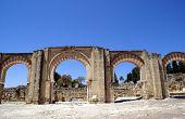The arched entrances of the ancient palace of Medina Azahara in Cordoba. Tourists attraction in Spain. Historical place. Medina Azahara is the first ancient city in Europe. Travel. Holiday. poster