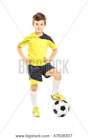 Full length portrait of a kid in sportswear posing with a soccer ball isolated on white background
