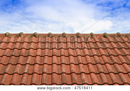 Tiled Roof With Fluffy Cloud Blue Sky