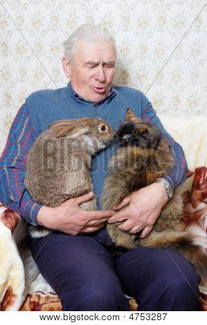 Elderly Man With Animal