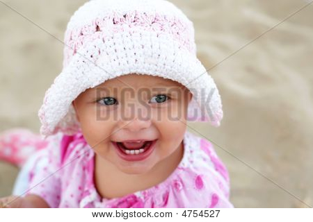Happy Baby Girl On The Beach