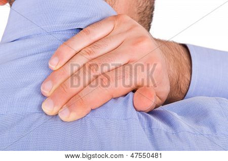 Businessman suffering from neck pain.