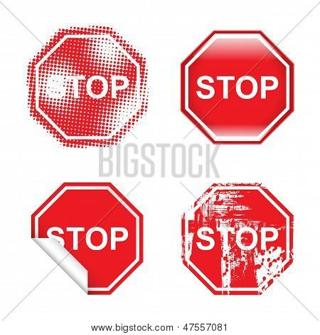A set of four stop signs with different graphic styles. poster