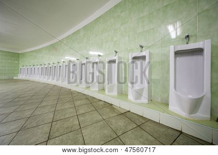 Row of urinals in a public toilet